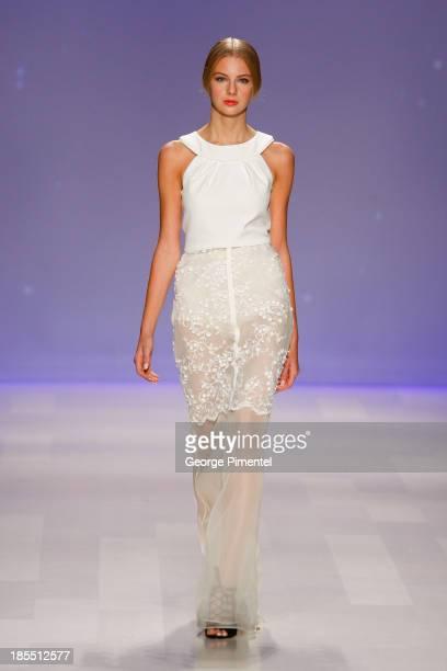 A model walks the runway wearing David Dixon spring 2014 collection during World MasterCard Fashion Week Spring 2014 at David Pecaut SquareÊon...