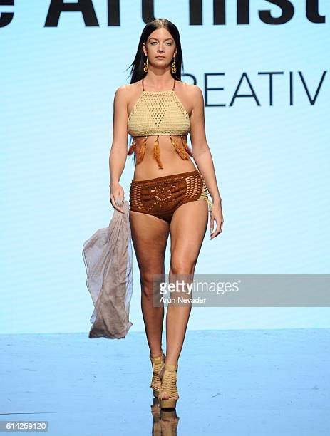 A model walks the runway wearing Debra Corrales at Art Hearts Fashion Los Angeles Fashion The Art Institutes Showcase on October 12 2016 in Los...