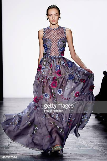 A model walks the runway wearing Dennis Basso Spring 2016 during New York Fashion Week The Shows at The Arc Skylight at Moynihan Station on September...