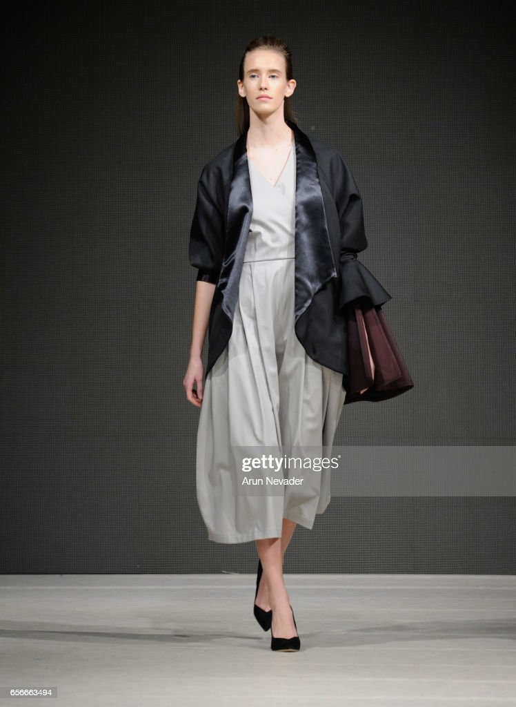 A model walks the runway wearing Designed by Beely at Vancouver Fashion Week Fall/Winter 2017 at Chinese Cultural Centre of Greater Vancouver on March 22, 2017 in Vancouver, Canada.