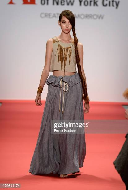A model walks the runway wearing designer Diana Isabel Sanchez Sacotto's collection at the The Art Institute Of New York City Spring 2014 fashion...