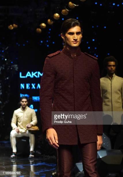 Model walks the runway wearing designer Kunal Rawal at Lakme Fashion Week winter collection 2019 at St Regis Hotel on August 24, 2019 in Mumbai,...
