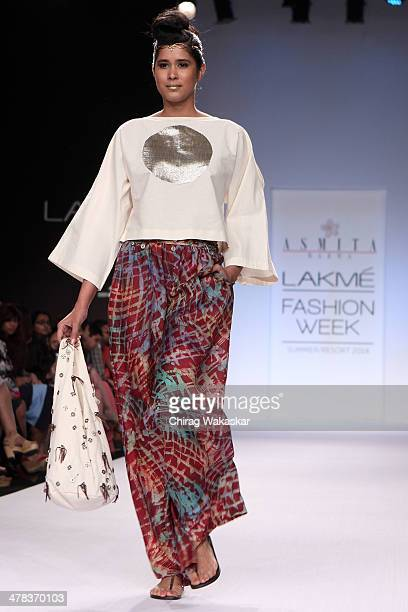 A model walks the runway wearing designs by Asmita Marwa at day 3 of Lakme Fashion Week Summer/Resort 2014 at the Grand Hyatt on March 13 2014 in...