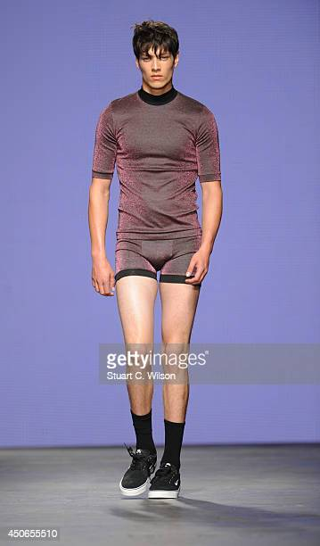 A model walks the runway wearing designs by Bobby Abley part of the MAN show during the London Collections Men SS15 at The Old Sorting Office on June...