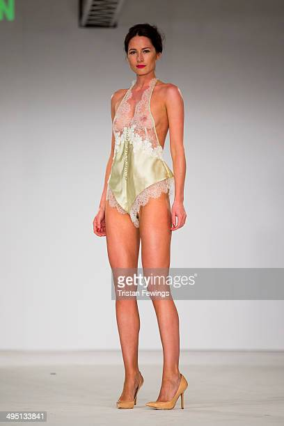A model walks the runway wearing designs by Charlie Watson during the De Montfort Contour show during day 2 of Graduate Fashion Week 2014 at The Old...