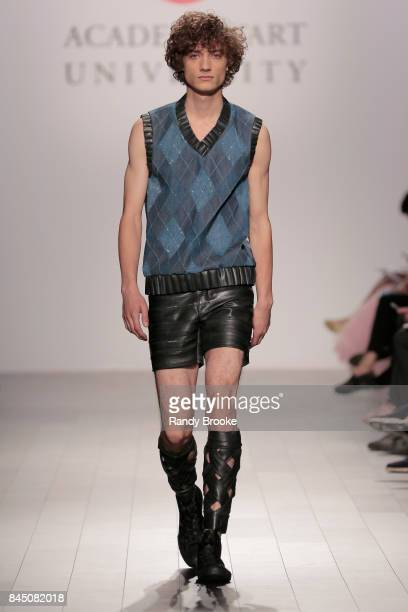 A model walks the runway wearing designs by Eden Slezin for Academy Of Art University SS2017 FW2018 Menswear And Womenswear Collections Fashion Show...