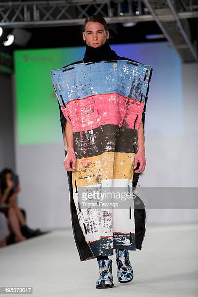 A model walks the runway wearing designs by Harriet Crawley during the University of Northampton show during day 3 of Graduate Fashion Week 2014 at...