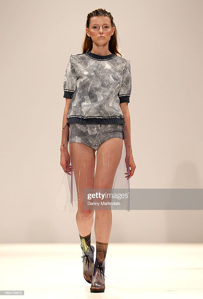 A model walks the runway wearing designs by Helen Lawrence at the Ones to Watch show at the Fashion Scout venue during London Fashion Week SS14 at Freemasons Hall on September 13, 2013 in London, England.