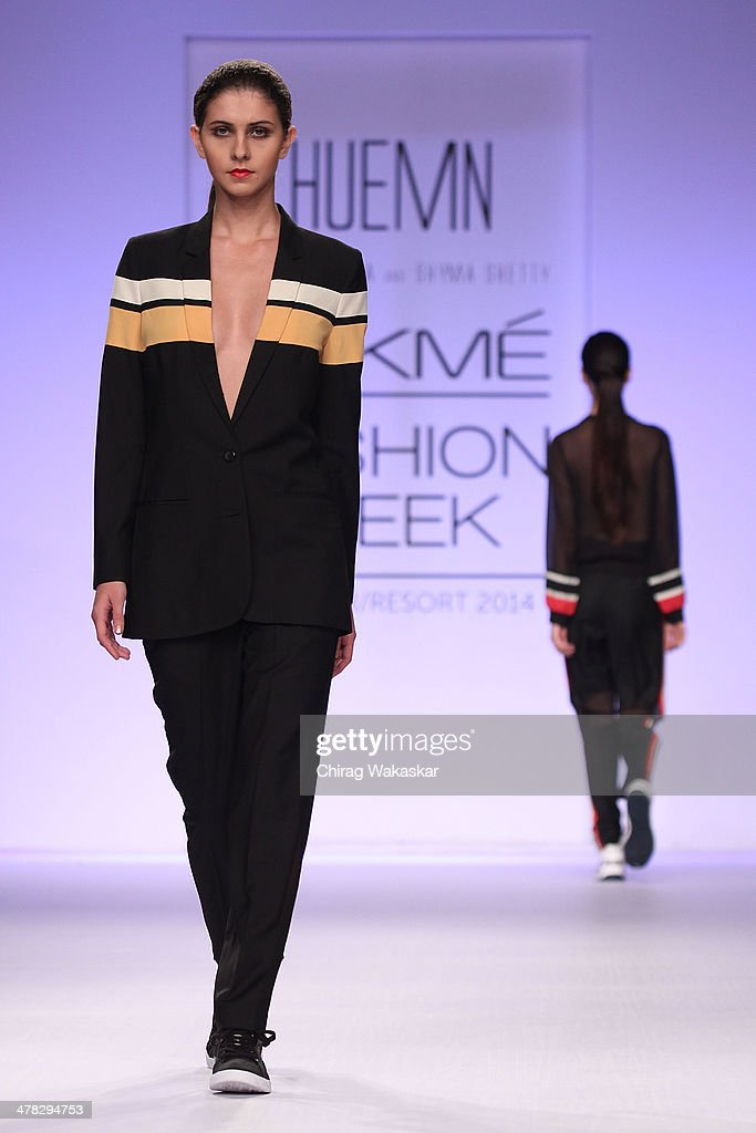 A model walks the runway wearing designs by Huemn at day 2 of Lakme Fashion Week Summer/Resort 2014 at the Grand Hyatt on March 12, 2014 in Mumbai, India.
