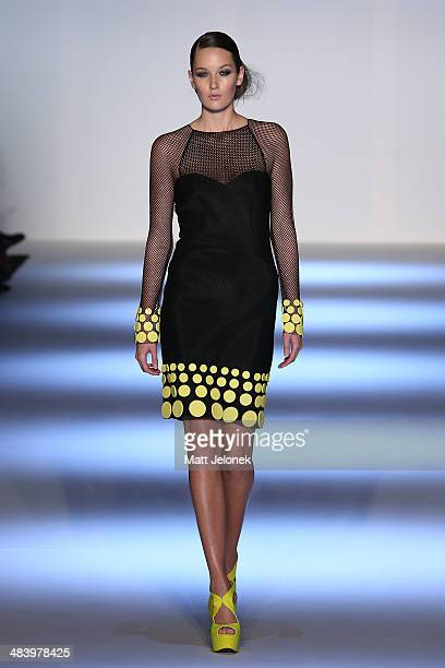 Model walks the runway wearing designs by Logvin Cove at the Innovators show at Mercedes-Benz Fashion Week Australia 2014 on April 10, 2014 in...