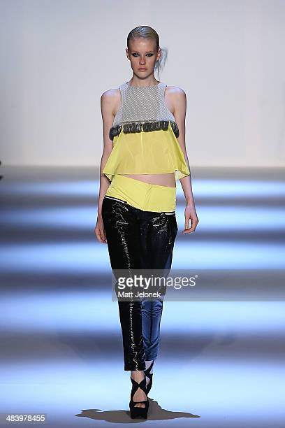 A model walks the runway wearing designs by Logvin Cove at the Innovators show at MercedesBenz Fashion Week Australia 2014 on April 10 2014 in Sydney...