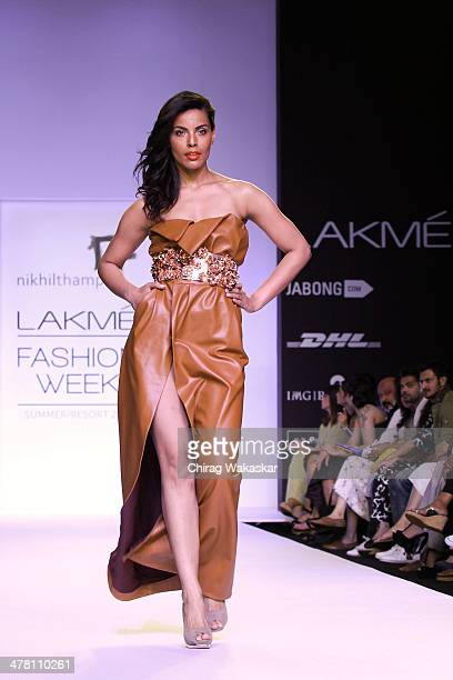 A model walks the runway wearing designs by Nikhil Thampi at day 2 of Lakme Fashion Week Summer/Resort 2014 at the Grand Hyatt on March 12 2014 in...