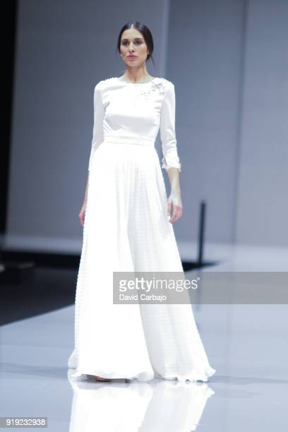 A model walks the runway wearing designs by Rocio Osorno on day tree of Code 41 on February 16 2018 in Seville Spain