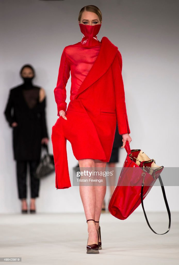 A model walks the runway wearing designs by Sabrina Pilkati from the Accademia di Costume e di Moda during the International Catwalk Competition show during day 4 of Graduate Fashion Week 2014 at The Old Truman Brewery on June 3, 2014 in London, England.
