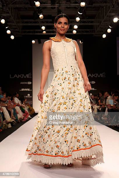 A model walks the runway wearing designs by Shruti Sancheti at day 4 of Lakme Fashion Week Summer/Resort 2014 at the Grand Hyatt on March 14 2014 in...