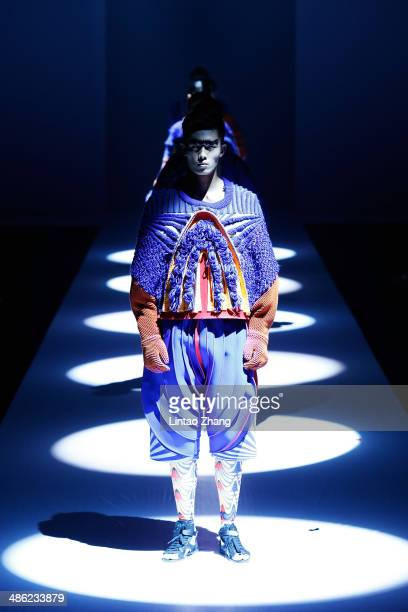 Model walks the runway wearing designs the by China Academy of Art School of Design Graduates Show during the 2014 China Graduate Fashion Week at the...