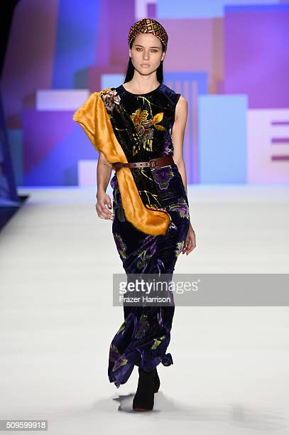 Model walks the runway wearing Desigual Fall 2016 during New York Fashion Week: The Shows at The Arc, Skylight at Moynihan Station on February 11,...
