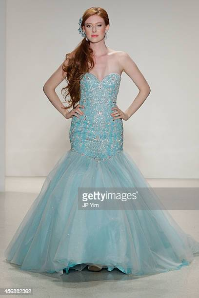A model walks the runway wearing Disney Fairy Tale Weddings by Alfred Angelo Collection at EZ Studios on October 8 2014 in New York City