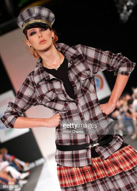 A model walks the runway wearing Divino by Daniel Hoyos during the second day of Colombia Moda 2009 at Plaza Mayor on July 28 2009 in Medellin...
