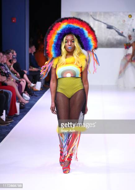 Model walks the runway wearing Dominion Couture Costume by Tara Bryant Johnson during NYFW Powered By hiTechMODA on September 06, 2019 in New York...