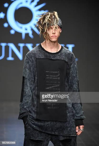 A model walks the runway wearing Dunyah at Los Angeles Fashion Week Powered by Art Hearts Fashion LAFW FW/18 10th Season Anniversary at The MacArthur...