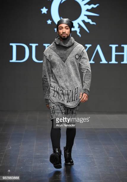 Model walks the runway wearing Dunyah at Los Angeles Fashion Week Powered by Art Hearts Fashion LAFW FW/18 10th Season Anniversary at The MacArthur...