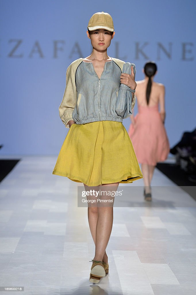 A model walks the runway wearing Eliza Faulkner spring 2014 collection during the Mercedes-Benz Start-Up national final at World MasterCard Fashion Week Spring 2014 at David Pecaut Squareat David Pecaut Square on October 22, 2013 in Toronto, Canada.