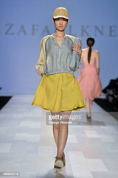 A model walks the runway wearing Eliza Faulkner spring 2014 collection during the MercedesBenz StartUp national final at World MasterCard Fashion...