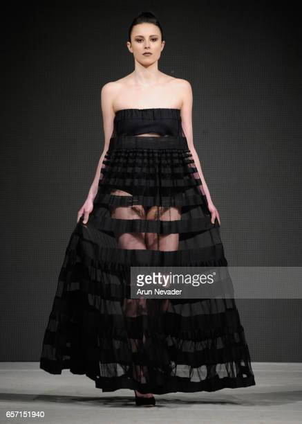 Model walks the runway wearing Essvi at Vancouver Fashion Week Fall/Winter 2017 at Chinese Cultural Centre of Greater Vancouver on March 23, 2017 in...