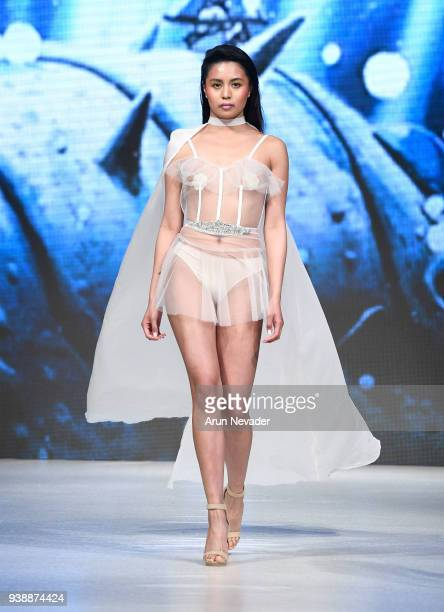 A model walks the runway wearing Evan Clayton at 2018 Vancouver Fashion Week Day 6 on March 24 2018 in Vancouver Canada