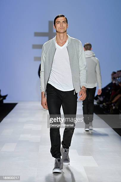 A model walks the runway wearing Faded Lifestyle spring 2014 collection during the MercedesBenz StartUp national final at World MasterCard Fashion...