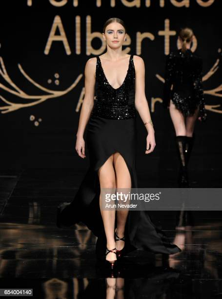 A model walks the runway wearing Fernando Alberto Atelier at Art Hearts Fashion LAFW Fall/Winter 2017 Day 2 at The Beverly Hilton Hotel on March 15...