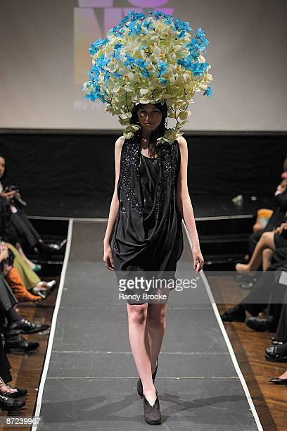 A model walks the runway wearing Form New York in collaboration with Preston Bailey at the 8th annual Tulips Pansies A Headdress Affair at The Edison...