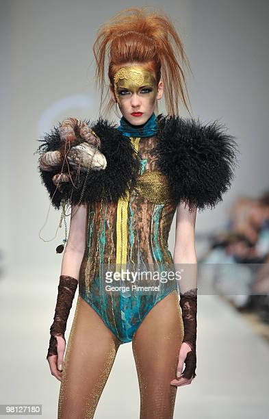 A model walks the runway wearing Gaudet's Fall 2010 collection at the Allstream Centre on March 29 2010 in Toronto Canada
