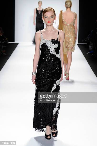 A model walks the runway wearing Gianni Tolentino at the FLT Moda Art Hearts Fashion show presented by AIDS Healthcare Foundation during MercedesBenz...