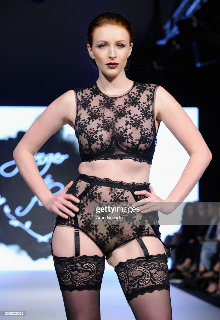 A model walks the runway wearing Ginger & Flora at Vancouver Fashion Week Fall/Winter 2017 at Chinese Cultural Centre of Greater Vancouver on March 22, 2017 in Vancouver, Canada.