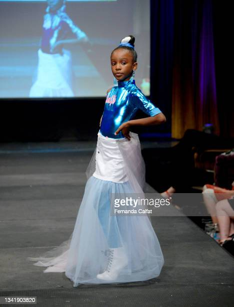 Model walks the runway wearing Glam2Glo Designz at NYFW hiTechMODA Season 6 at The Edison Ballroom on September 12, 2021 in New York City.