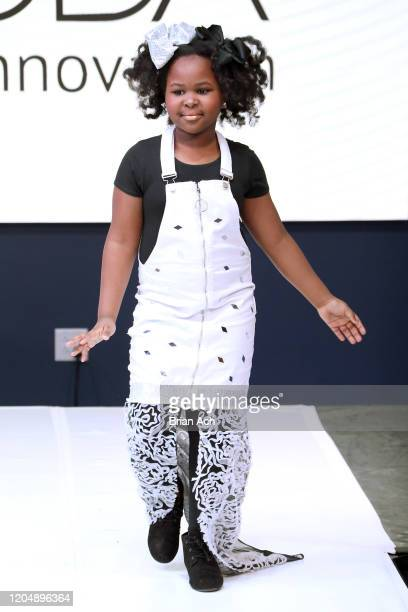 Model walks the runway wearing Glam2Glo Designz during NYFW Powered By hiTechMODA on February 08, 2020 in New York City.