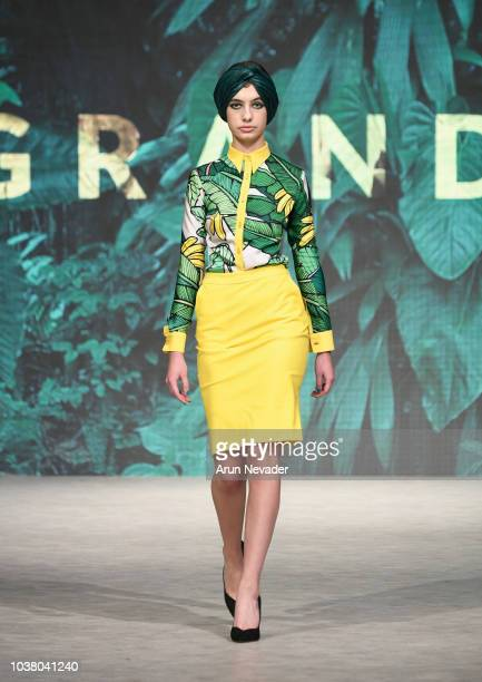 A model walks the runway wearing GRANDI at Vancouver Fashion Week Spring/Summer 19 Day 5 on September 21 2018 in Vancouver Canada