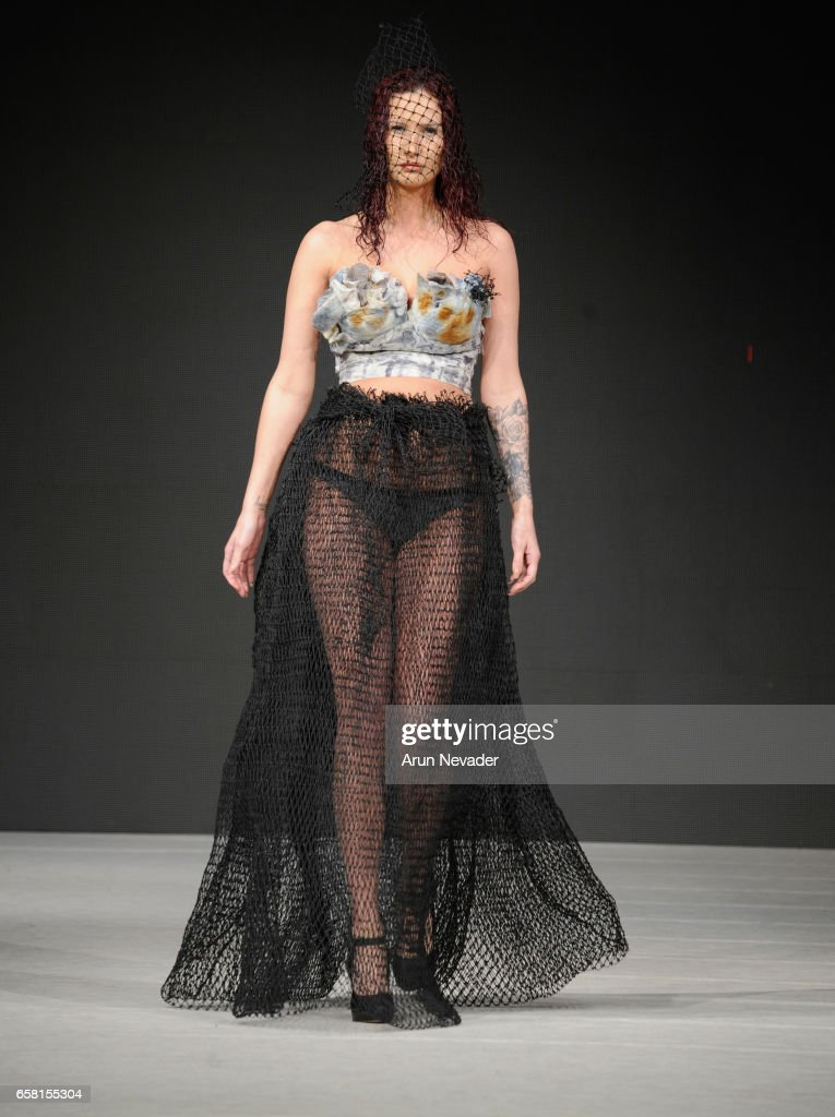 A model walks the runway wearing Green Embassy at Vancouver Fashion Week Fall/Winter 2017 at Chinese Cultural Centre of Greater Vancouver on March 26, 2017 in Vancouver, Canada.