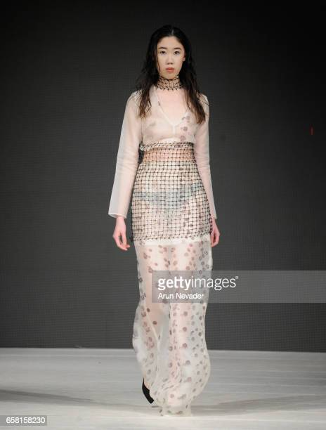 Model walks the runway wearing Green Embassy at Vancouver Fashion Week Fall/Winter 2017 at Chinese Cultural Centre of Greater Vancouver on March 26,...