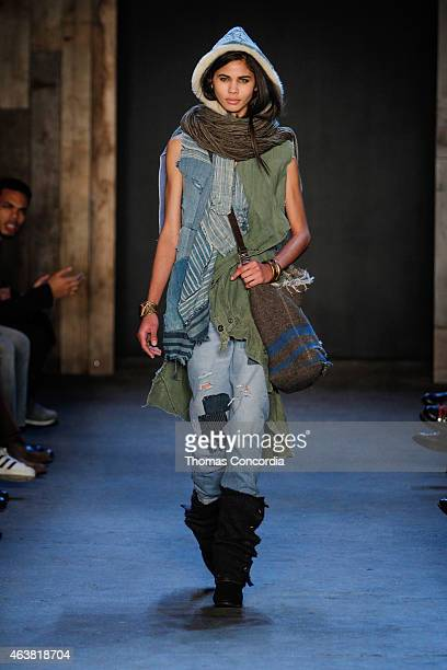 A model walks the runway wearing Greg Lauren Fall 2015 during MercedesBenz Fashion Week at ArtBeam on February 18 2015 in New York City