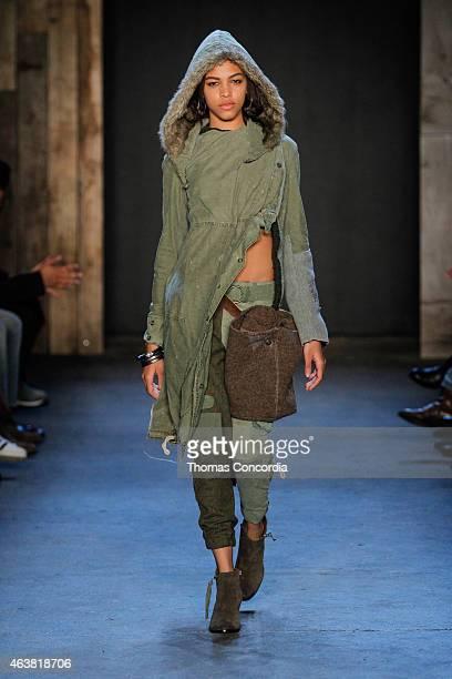 A model walks the runway wearing Greg Lauren Fall 2015 during MercedesBenz Fashion Week at ArtBeam on February 18 2015 in New York City