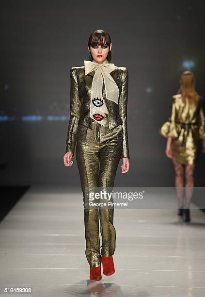A model walks the runway wearing Greta Constantine 2016 collection during Toronto Fashion Week Fall 2016 at David Pecaut Square on March 18 2016 in...