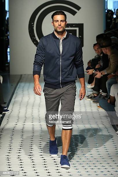 A model walks the runway wearing Grungy Gentleman during New York Fashion Week Men's S/S 2016 at The Supermarket on July 15 2015 in New York City