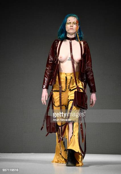 A model walks the runway wearing Hannah Erikson at 2018 Vancouver Fashion Week Day 3 on March 21 2018 in Vancouver Canada