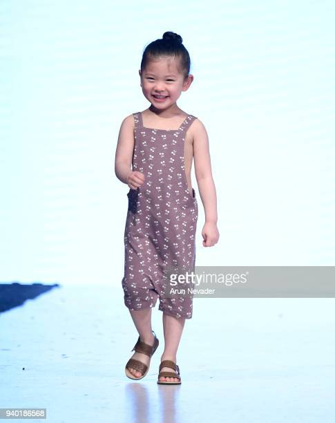 A model walks the runway wearing Haven Kids at 2018 Vancouver Fashion Week Day 7 on March 25 2018 in Vancouver Canada