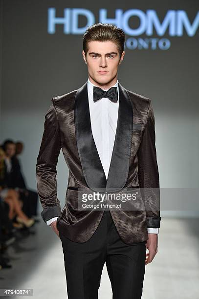A model walks the runway wearing HD Homme fall 2014 collection during World MasterCard Fashion Week Fall 2014 at David Pecaut Square on March 18 2014...