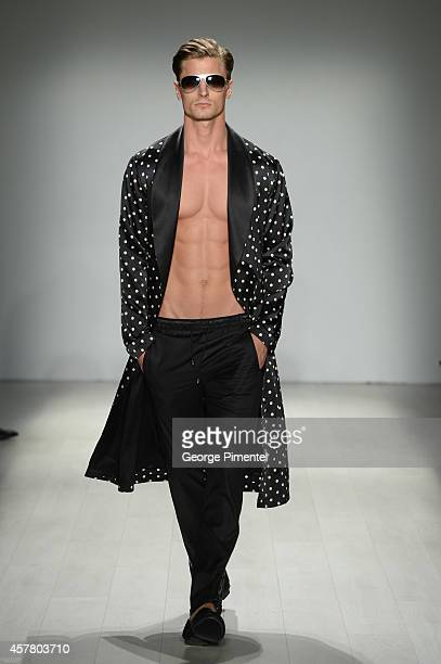 A model walks the runway wearing HD Homme spring 2015 collection during World MasterCard Fashion Week Spring 2015 at David Pecaut Square on October...