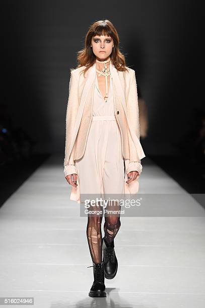 A model walks the runway wearing Helder Diego 2016 collection during Toronto Fashion Week Fall 2016 at David Pecaut Square on March 16 2016 in...